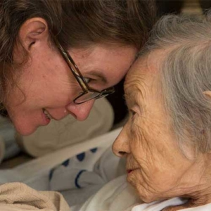 a Hospice nurse and patient share an intimate moment